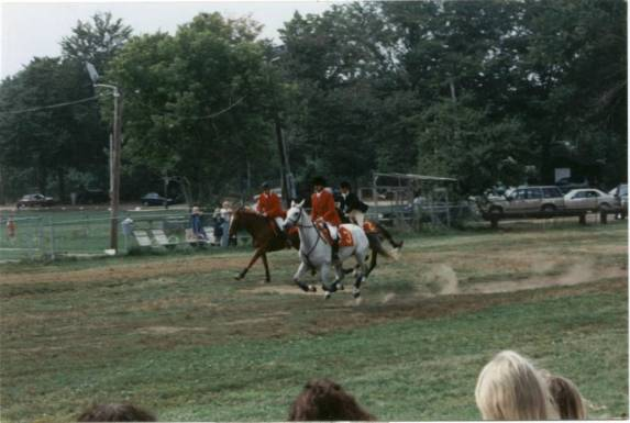 Russell Therrien on Polly (number 3) pulls into the lead in the home stretch in the Masters Race.